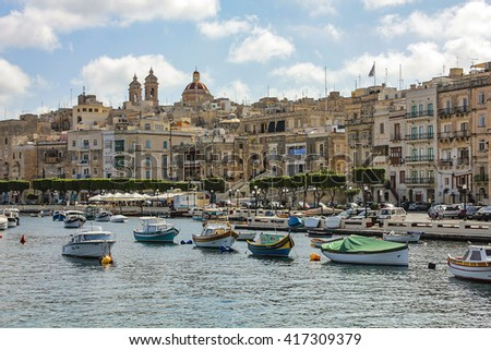 MALTA, VALLETTA - MARCH 20 2016: View over the Grand Harbour from Valletta, Malta. This a natural harbour and has been used as a harbour since at least Phoenician times - stock photo