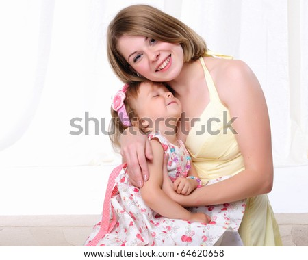 Mama and her little daughter together having fun - stock photo