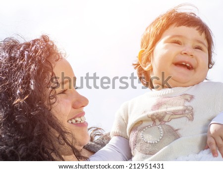 mama with baby in a moment of happiness - stock photo
