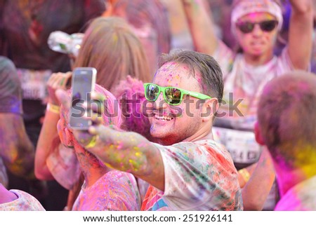 MAMAIA, CONSTANTA, ROMANIA - JULY 26: Mamaia color run 2014, in Mamaia, Constanta, on July 26, 2014. People from all walks of life participating in the fun summer run - stock photo