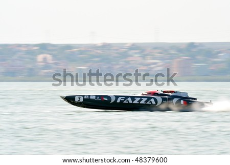 MAMAIA, ROMANIA - AUGUST 29: Boat Fazza 3 of Victory Team, the favorite, in first race of the Class One Romanian Grand Prix August 29, 2009 in Mamaia, Romania - stock photo