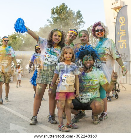 MAMAIA, ROMANIA - AUGUST 1, 2015. Happy  unidentified people at The Color Run 2015.The Color Run is a worldwide hosted fun which  promote healthiness and happiness by bringing the community together .