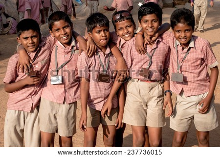 MAMALLAPURAM, INDIA - JAN 20: Unidentified hindu school children dressed in uniform go home after classes on January 20, 2013 in Madurai, Tamil Nadu, Southern India  - stock photo