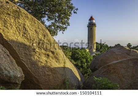 MAMALLAPURAM, INDIA - NOVEMBER 14: Visitors taken in the grand vista of the surrounding landscape from the top of the modern lighthouse on November 14, 2012 in Mamallapuram, Tamil Nadu, India. - stock photo