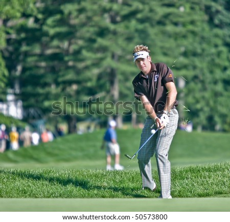 MAMARONECK, NY - JUNE 13: Englishman Ian Poulter chips onto the green as he plays in the 2006 US Open on June 13, 2006 in Mamaroneck, NY. - stock photo