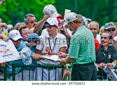 MAMARONECK, NY - JUNE 13: Popular South African, Ernie Els, signs autographs for his fans after playing in the 2006 US Open on June 13, 2006 in Mamaroneck, NY. - stock photo