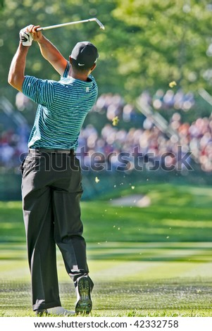 MAMARONECK, , NY - JUNE 13: Tiger Woods prepares to play, but missed the cut, in the 2006 US Open at Winged Foot on June 13, 2006 in Mamaroneck, NY. - stock photo