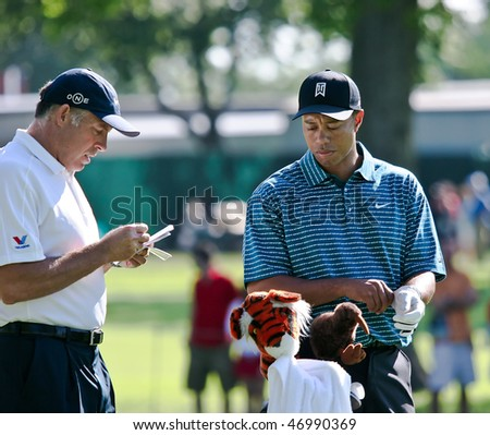 MAMARONECK, , NY - JUNE 13: With the help of his caddy, Steve Williams, Tiger selects the club for his next shot as he plays in the 2006 US Open on June 13, 2006 in Mamaroneck, NY. He missed the cut. - stock photo