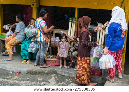 Mamasa, Sulawesi, Indonesia - August 20, 2014: Unidentified group of women shopping at local market in Mamasa region, South Sulawesi, Indonesia. Concept of local lifestyles and traditional cultures. - stock photo