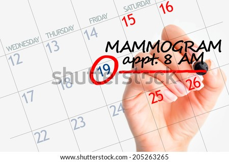 Mammography appointment on calendar - stock photo