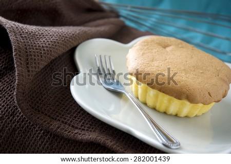 mamon sponge cake, philippines classic cake on dish - stock photo