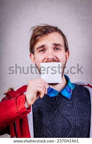 Man  a blank paper hiding his face - stock photo