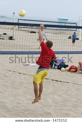Man about to hit the ball in a game of volleyball - stock photo