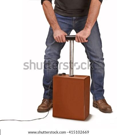 Man activating explosive detonator box. - stock photo