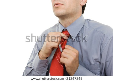 Man adjusting red tie - isolated - stock photo