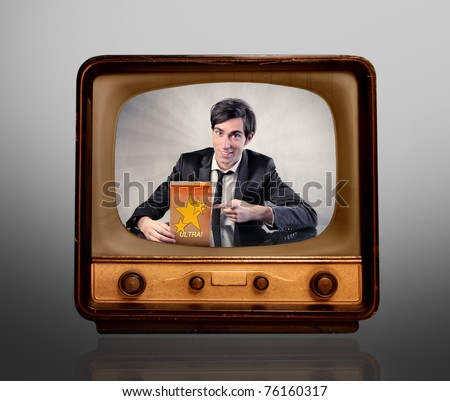 Man advertising a product on the television - stock photo