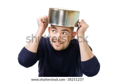 Man afraid and protecting his head holding casserole,isolated on white - stock photo