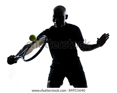 man african afro american playing tennis player backhand, on studio isolated on white background - stock photo