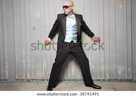 Man against the wall - stock photo