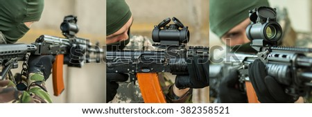 man aiming with an AK-47 with reflex sight