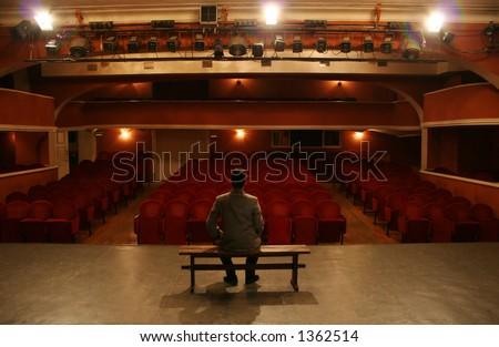 man alone on theater scene - stock photo
