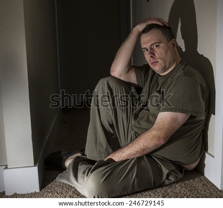Man along and sad just staring intent at the camera - stock photo