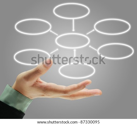 man analysing flowchart schema on the whiteboard - stock photo