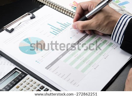 Man Analysis Business and financial report. - stock photo