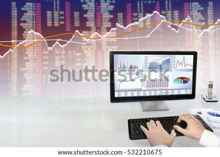 Man analyzing financial data and charts on computer