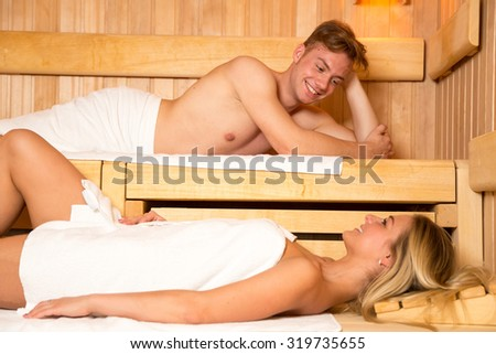 Man and a woman enjoying wellness day in the sauna - stock photo