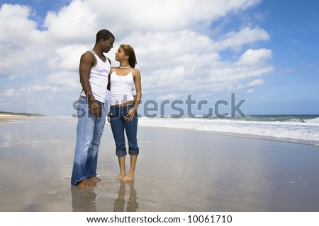 Man and a woman on a beach - stock photo
