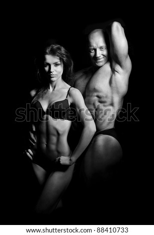 man and a woman trained in the gym - stock photo