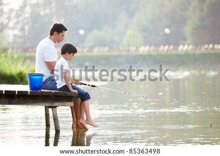 Man and boy fishing on the lake