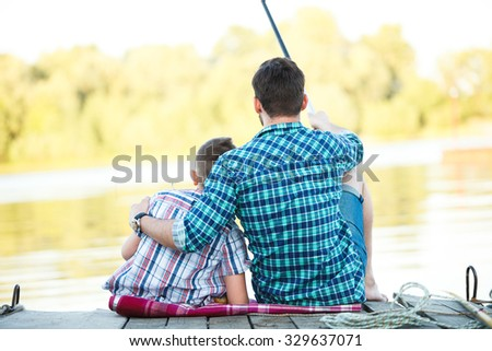 Man and boy fishing on the lake, Father and son fishing - stock photo