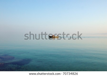 Man and boy in the boat - stock photo