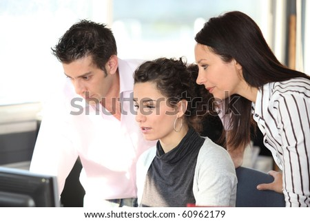 Man and businesswomen in office