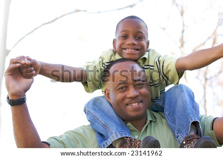 Man and Child Having fun in the park. - stock photo
