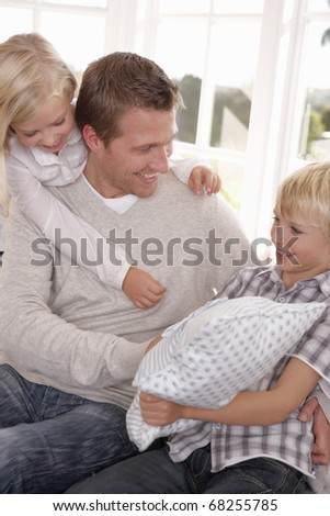 Man and children play together