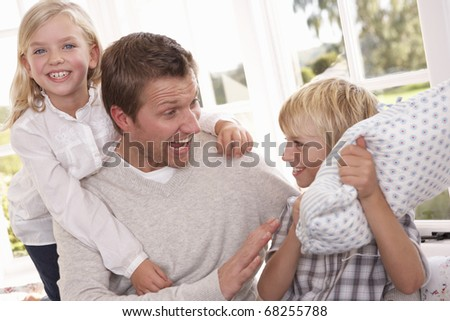 Man and children play together - stock photo