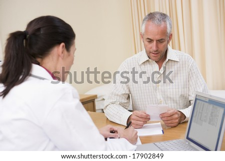 Man and doctor talking in office