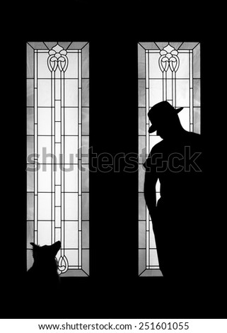 Man and dog silhouette wearing fashionable gangster mafia hat in decorative door window looking mysterious solitary meditative reflective lonely thoughtful dangerous serious as an outcast secret - stock photo