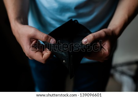 Man and empty wallet - stock photo
