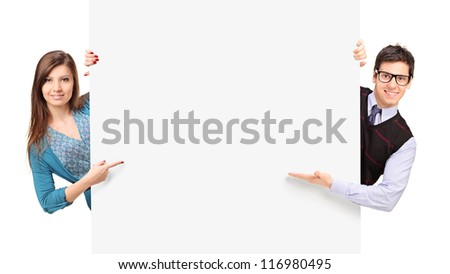 Man and female posing behind a blank panel isolated on white background - stock photo