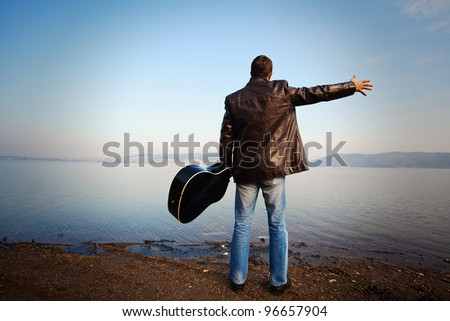 man and guitar - stock photo