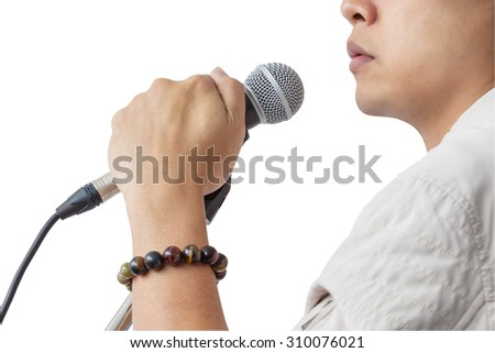 Man and hand holding Microphone stand sing song isolated on white background, closeup - stock photo