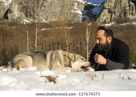Man and his Czechoslovakian wolf dog - stock photo
