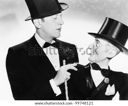 Man and his puppet looking at each other - stock photo