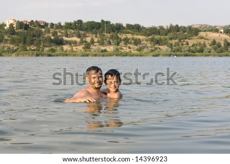 Man and his son playing in the water