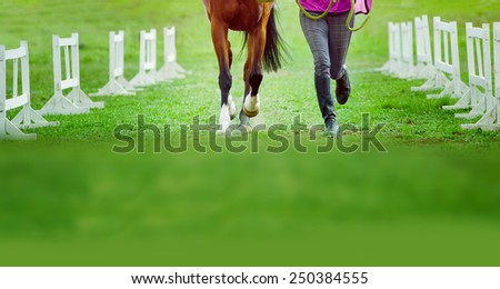 man and horse run together at equestrian sports events - stock photo