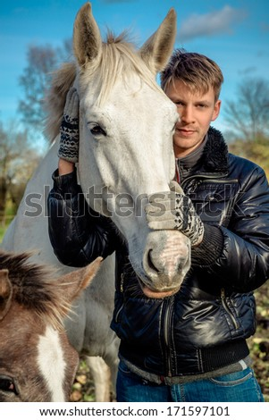 Man and horses outdoors - stock photo